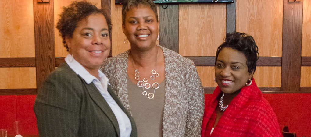 Mrs. Coleman poses with members of Women of Prince George's County
