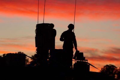 Members of the United States Army working at dawn