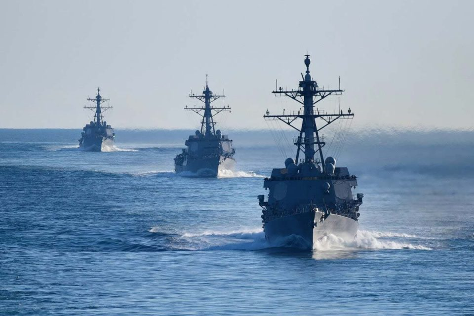 Naval ships on an open body of water