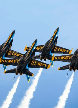 The Blue Angels flying in tight formation
